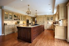 I love how the stained island is offset from the rest of the kitchen.  Beautiful kitchen with a french flair!