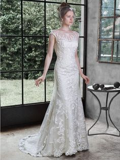 Maggie Sottero - NANETTE, The pinnacle of romance in found in this stunning wedding dress