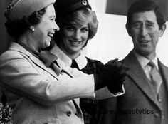 September 4, 1982: Prince Charles, Princess Diana with Queen Elizabeth II laughing after her hands became stuck together when shaking hands with the winner of the caber toss at the Braemar Highland Games. The athlete had warned the queen that he had been unable to wash the resin off his hands.