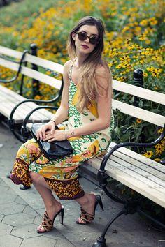 Printed maxi dress, patent leather clutch, leopard mules via http://www.ontheracks.com/