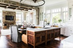 transitional style home. Decadent home in Utah blends French farmhouse with transitional style. (Image Courtesy of Tonya Olsen Design) Stone Kitchen, New Kitchen, Kitchen Ideas, Paris Kitchen, Round Kitchen, Kitchen Photos, Kitchen Cabinetry, Kitchen Countertops, Stone Countertops