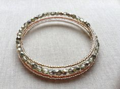 Mixed Metal Bracelet // Glass Beaded Bracetlet // Memory Wire // Salty Sparrow Designs // Copper Gold Silver on Etsy, $25.00