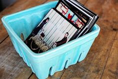Stack your favorite wedding snapshots in a charming ceramic farmers market basket where friends and family can flip through them at their leisure.