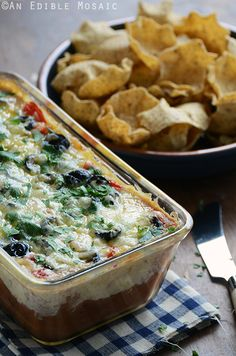 Cheesy Warm Bean Dip- This layered dip can be made ahead and prepared in a loaf pan for an easy transportable appetizer that can be baked off on site and served in the same dish.