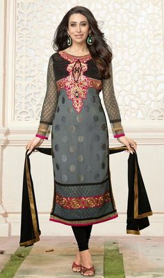 Gray georgette churidar dress will lend you a charm like it does Karisma Kapoor. This stunning attire is showing some incredible embroidery done with lace, patch, resham and stones work. #BollywoodFancySuitDesign