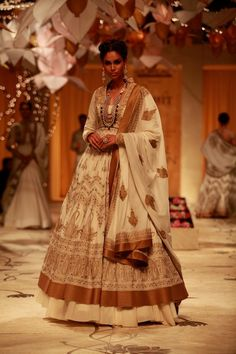 """Model walking on the ramp showcasing Rohit Bal's """"Mulmul"""" collection at the Amby Valley India Bridal Fashion Week. #Fashion #Style #Beauty #Bollywood"""