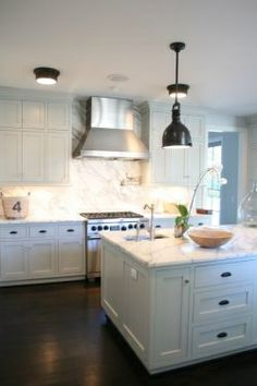 White cabinets, bronze knobs