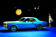 1964 Ford Mustang.  My first car.  I wish I still had it.  It was powder blue, 4-speed 289 V-8 and could really haul a--.