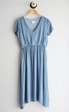 Quite possibly the best midi dress ever! It has an elastic waist band so you can easily just pull it over your head -- NO ZIPPER HEADACHE! Short sleeve length gives perfect coverage for a more flattering look. It's fully lined! Fits true to size. This will be a staple in your closet!! small: 0-4, medium: 4-8, large: 8-14 100% Rayon Dry Clean or Handwash is recommended