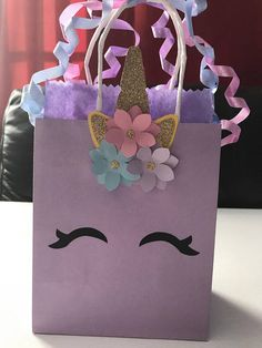 These unicorn favor bags are perfect for any celebration! Approximately 6.25 in x 5. 25 in. x 3 in for pink and purple bags. Dont let your guests leave empty handed! Pass out these creative giveaways at the end of your party. Have a magical party! Made to order Can be customized