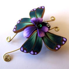 Polymer clay butterfly...clay by kim on etsy...love her work