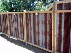 The rustic corrugated tin fence my husband and I built. Made from recycled corrugated tin bought from a farmer in Iowa. Love the rust patina!!!