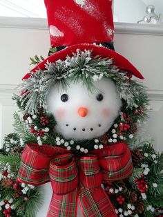 This handmade Snowman wreath is so unique that no one in the neighborhood will have one like it. Its not just for Christmas - this wreath can be hung all Winter long indoors or outdoors. This wreath should have a little shelter from the elements if hung outside. Measures approximately