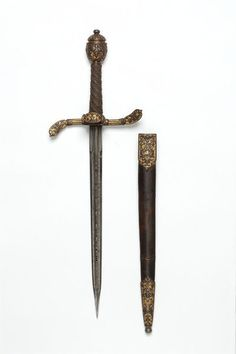 Early 17th century German (Munich) Left hand dagger and sheath at the Victoria and Albert Museum - No, this was not used by a left-handed person. Rather, in the fencing styles of the time, the swordsman would hold his sword in his right hand, and a dagger in his left; this was used both for parrying and close-range fighting.