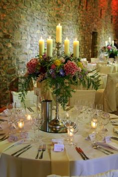 The tables were dressed with a combination of high and low table designs, our Baroque Candelabras were surrounded by a wreath of voluptuous blooms in an array of vibrant colour