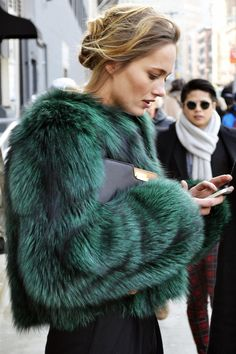 Model Karmen Pedaru looks ab fab in a rich emerald fur..hope its fake fur but still beautiful