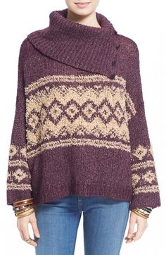 A nubby Fair Isle pattern is knit into a slouchy wool-blend sweater accented by a chunky split turtleneck with oversized button details.