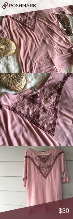🌸BKE Pink Boho Lace Panel Top🌸 70% Rayon 30% Cotton  Bust: 44 inches  Length: 23 inches - front  30 inches - back This light pink boho high-low ( the kind with two completely different lengths and a slit on the sides, not a swing one) top with geometric lace paneling and complimentary embroidery is gorgeous! The front and back feel different, but are both opaque and super soft. There's some slight damage as there's a little hole and a dark pink spot at the center of the back of the neck…