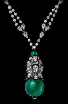 White gold, one 66.90 carat cabochon-cut emerald, black lacquer, brilliants.
