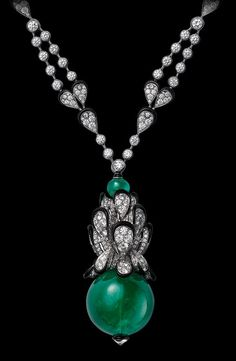 Indian Influences – High Jewelry Necklace White gold, one 66.90 carat cabochon-cut emerald, black lacquer, brilliants.