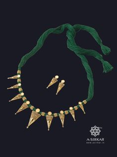Contai Necklace : Half-and-half graded hand-wrought cones interspersed with little wire ball rings strung with loose green thread make for a light but astonishingly lovely necklace.Though unintentional, there's something primal about it. With Matched eartops, all in 22K glossy gold.