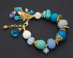 Items similar to Islands Charm Bracelet with Natural Turquoise, Coral and Gold on Etsy