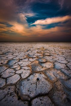 Africa | The dried up salt pans of the Makgadikgadi in Botswana crack in the heat of summer forming wonderous patterns and shapes.  | © Mark Dumbleton