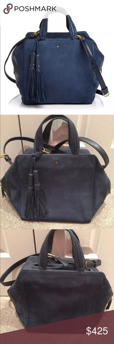 """Tory Burch Tassel Cube Satchel The first picture is a stock photo of the handbag, and all other pictures are of the actual bag. Stunning and gorgeous!! The suede leather is a gorgeous rich blue color. This bag was very gently used and in overall excellent condition. Dimensions: 10.5"""" W x 10.5H x 7.25""""D Top zip closure-Two zip pockets- Removable braided tassels-Top handles with 4.25"""" drop- Removable/adjustable shoulder strap with 23"""" drop- """"T"""" protective feet. All original packaging, box and…"""