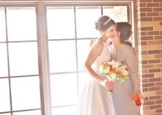 Intimate mother-daughter moment before wedding ceremony. Grey and orange themed. July. Indoor.
