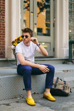 Shop this look on Lookastic:  https://lookastic.com/men/looks/white-crew-neck-t-shirt-navy-chinos-yellow-suede-loafers/613  — Yellow Suede Loafers  — Navy Chinos  — White Crew-neck T-shirt
