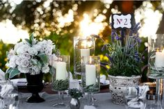 Hurricanes with rosemary rings   rustic-Ojai-garden-wedding-lavender-table-numbers