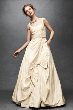 Cream wedding dress/bow accent/pockets [BHLDN] ...basically my dream dress. (love the messy updo too)