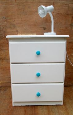 white wooden bedside table with turquoise knobs. by RosesUpcycled, $50.00. buy online at www.etsy.com/shop/rosesupcycled. Local pick up from East Malvern.