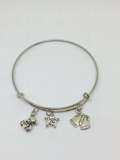 Charm Bangle Bracelet by Pinkarrowheadranch on Etsy https://www.etsy.com/listing/511227002/charm-bangle-bracelet