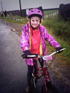 Tweeted by @BBCLookNorth - Holly from Holmfirth among those braving the rain for Paris Hill Climb.