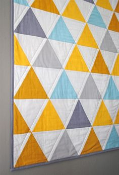 triangle quilt.  quilting done in progressively bigger triangles. love it.