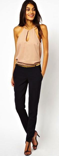sleeveless nude blouse with keyhole opening and black skinny pants, black heels