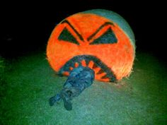 Painted Hay Bale eating a Hunter by Arlyn Brannen