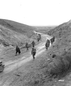 26 February 1943 - The Battle of the Kasserine Pass begins. The inexperienced American troops are soon forced to retreat. - The Battalion, Infantry Regiment of the United States Army marches through the Kasserine Pass. The Big Red One, Afrika Corps, North African Campaign, Erwin Rommel, United States Army, Military History, World War Two, Troops, Ww2