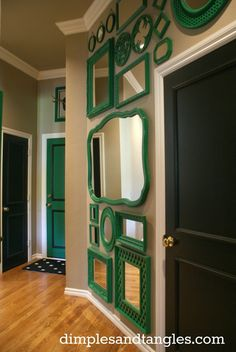 How fun! Love this wall of kelly green mirrors. Dimples and Tangles: