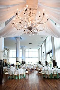 Custom dance floor structure with chandelier wedding reception decor. Events Luxe Wedding and Event Planning and Design Studio  www.eventsluxe.com  St. Louis, Mo.  314-669-5893  Please mention that you found them thru Jevel Wedding Planning's Pinterest Account.    Keywords: #missouriweddingplanner #weddingreceptiondecor #jevelweddingplanning Follow Us: www.jevelweddingplanning.com  www.facebook.com/jevelweddingplanning/