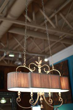Lighting fixture | unique lighting | champagne color | victorian architecture | hanging lights | hanging light fixture