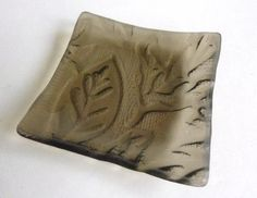 Here is a beautiful bronze square plate made from recycled window glass that has a beautiful leaves imprint in the back of the glass.