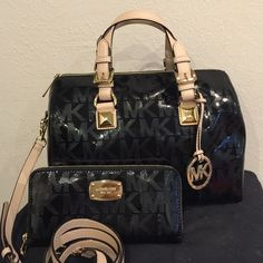 Sale New Michael Kors Metallic Purse andWallet New with tags 100% authentic Michael Kors black metallic and gold satchel and wallet set. Michael Kors Bags