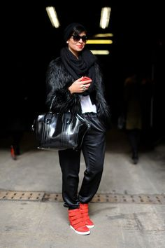 High-wattage wedged sneakers and slouchy leather pants made this a cool-girl mashup. #NYFW #StreetStyle