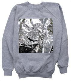 I know, let's stick a crumpled square of tinfoil to an ordinary gray sweatshirt and call it fashion!