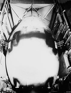 """The implosion-type nuclear weapon codenamed """"Fat Man"""" inside the """"Bockscar's"""" bomb bay, August What looks like black spray paint was actually liquid asphalt sprayed over the casing's seams to seal it. Ww2 Photos, Ww2 Pictures, Photographs, Us History, American History, Hiroshima, Nagasaki, Global Weather, Enola Gay"""
