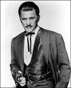 Kirk Douglas as Doc Holliday in Gunfight at the OK Corral, John Sturges' first telling of the Earp-Holliday story.