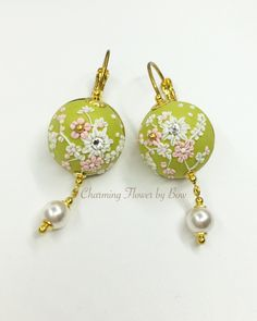 A personal favorite from my Etsy shop https://www.etsy.com/listing/261074497/flower-light-clay-earring-swarovski