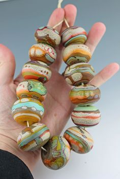 colourful hollows large strung hand by Aja Vaz / wandering spirit designs Polymer Clay Beads, Lampwork Beads, Handmade Beads, Earrings Handmade, Murano, Ceramic Jewelry, Jewelry Making Beads, How To Make Beads, Bead Art